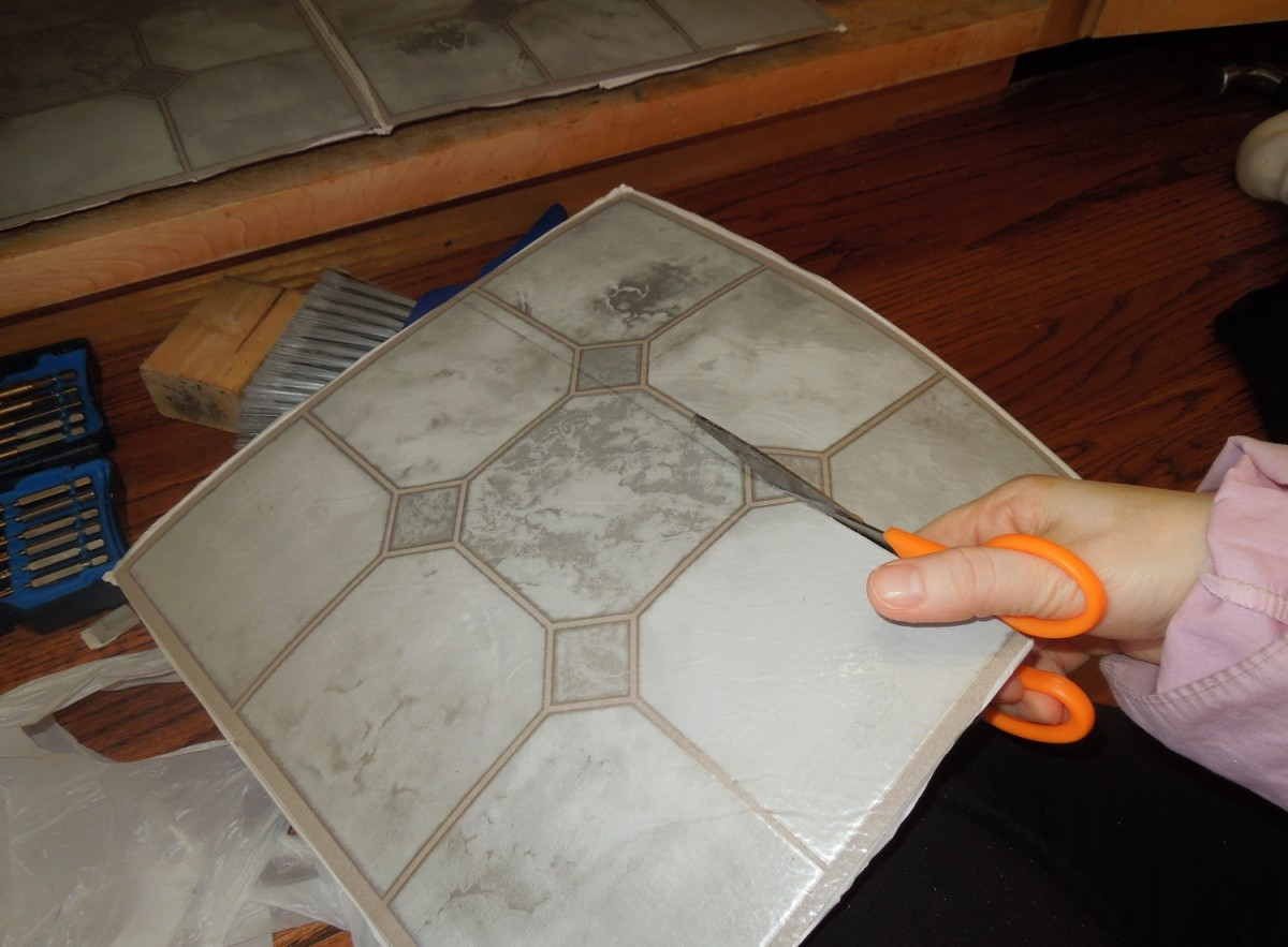 Cutting the Vinyl Tiles with A Pair of Scissors