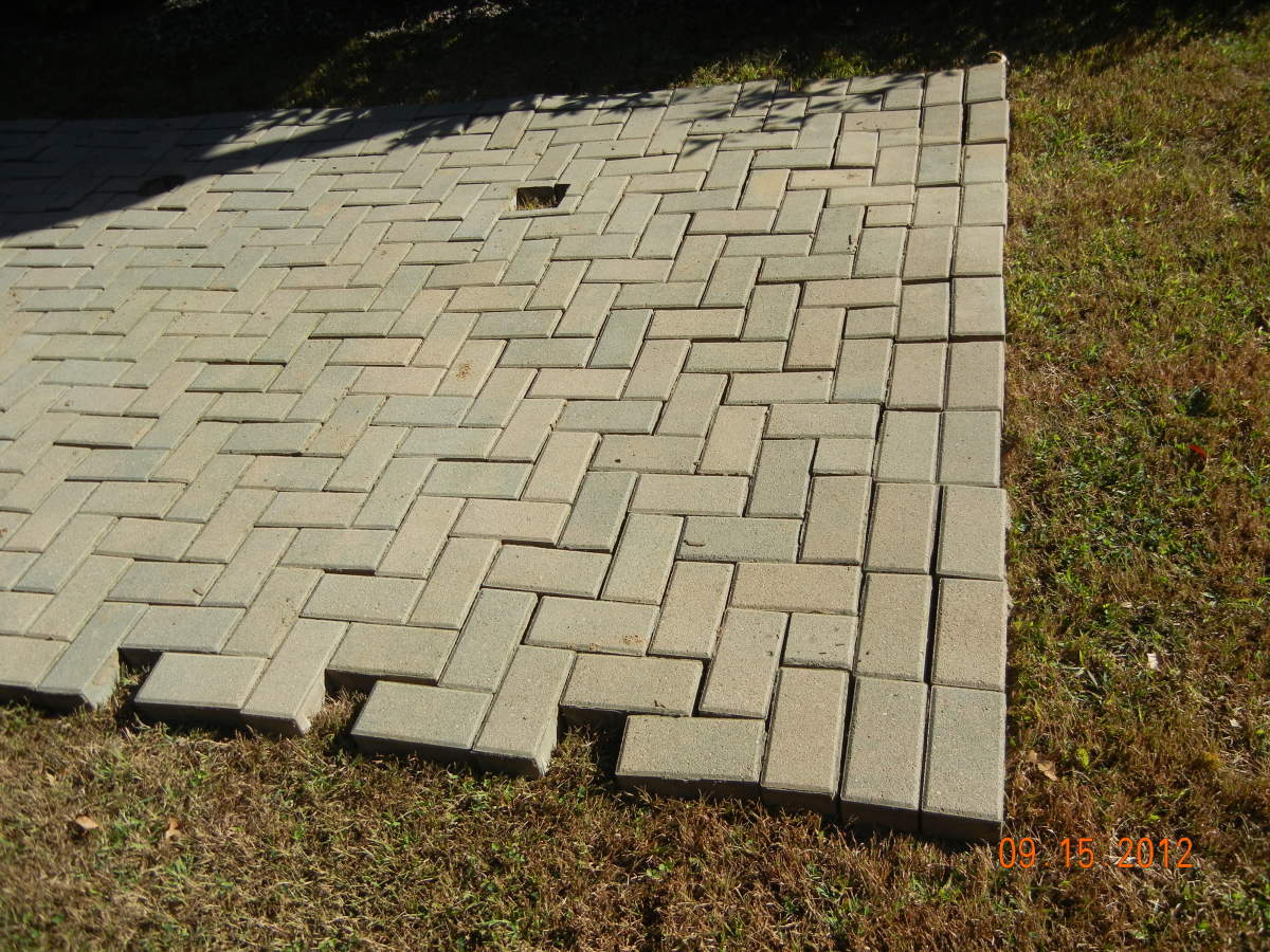 "Bricks pulled up from our patio and placed in our backyard till we were able to ""re-install"" them."
