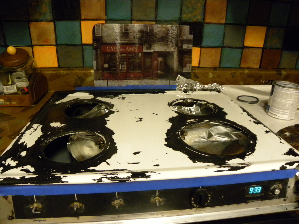 Stovetop disaster: Black paint was removed by oven cleaner spray.