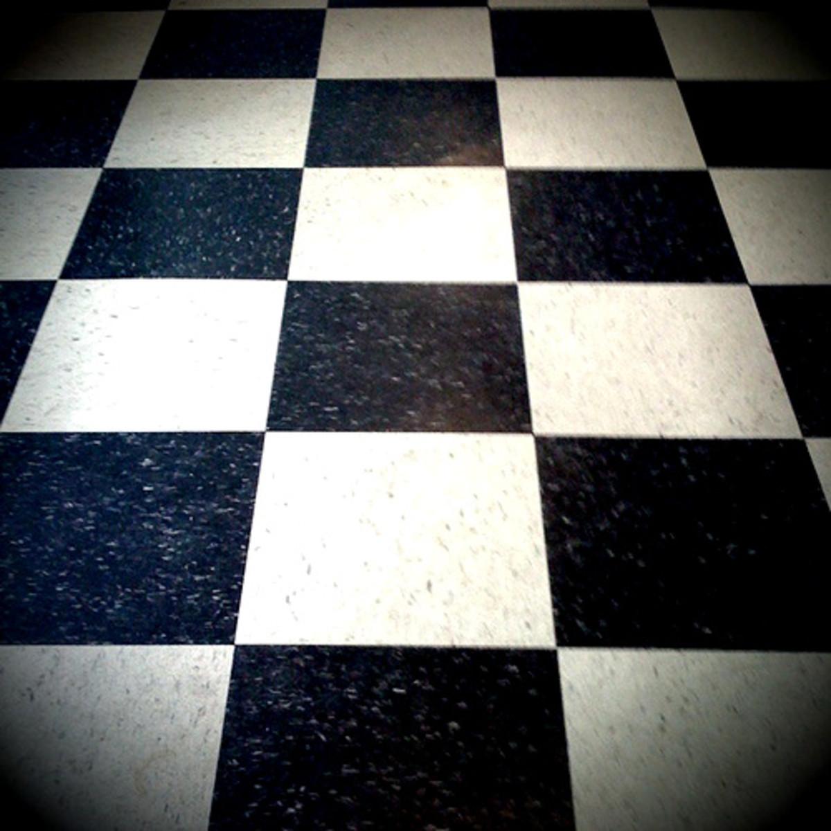Deco-style linoleum checkerboard floor.