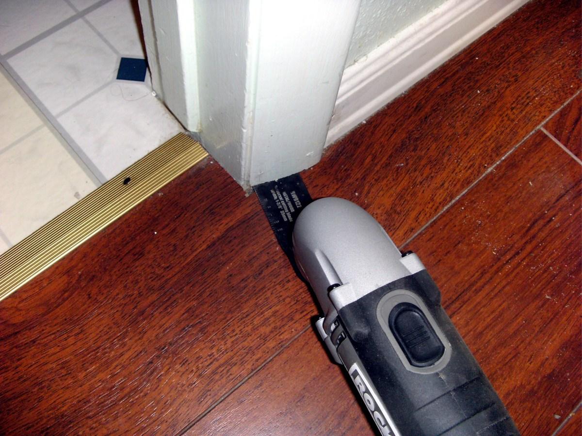 Cutting the door molding for the new hardwood floor.