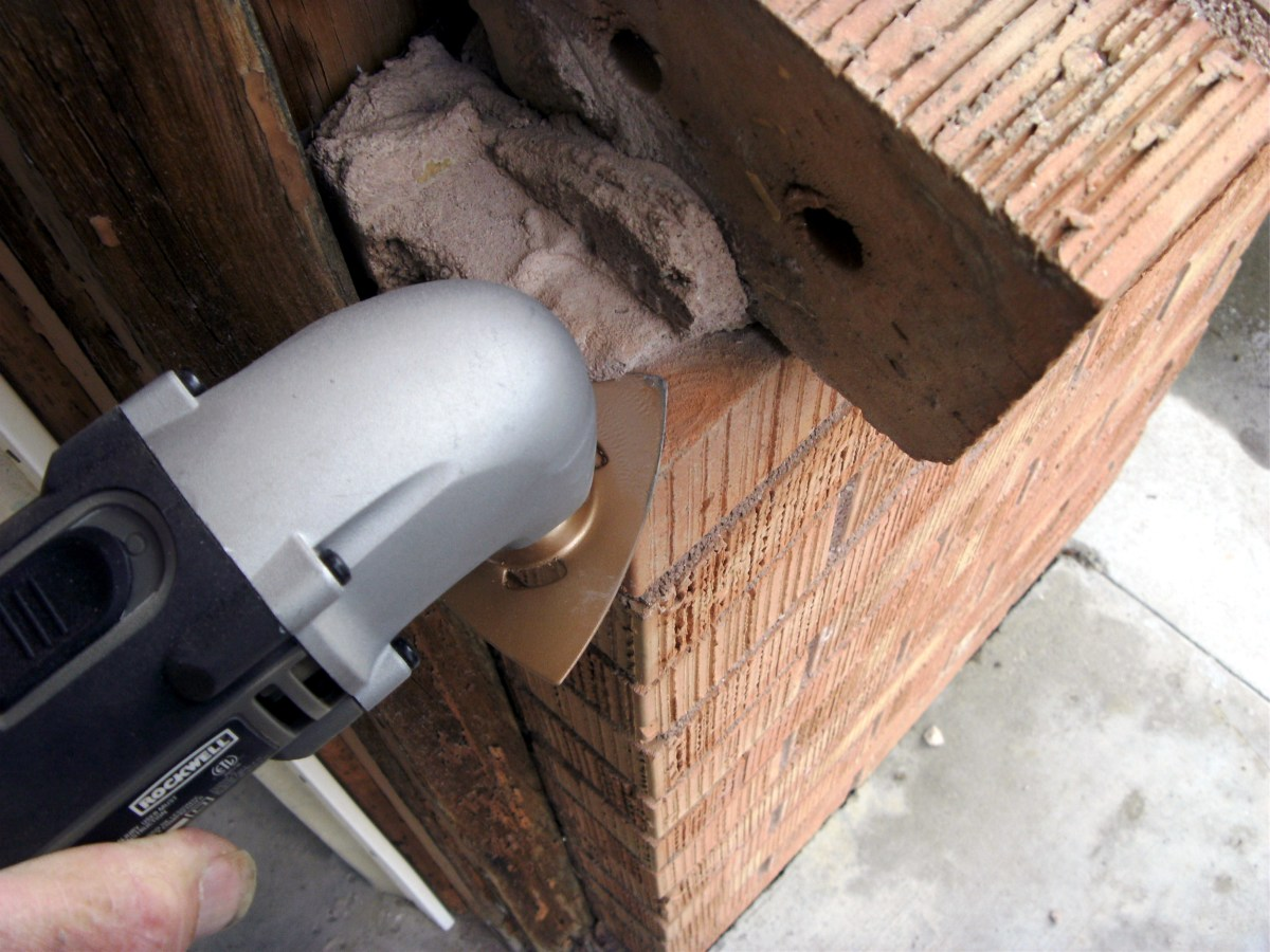 Removing grout with the carbide grinder.