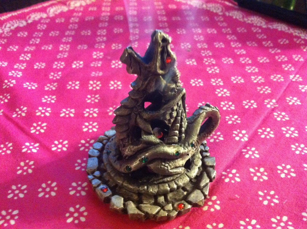 This pewter dragon burner looks like it's breathing smoke when burning cone incense.