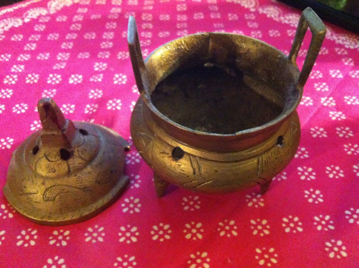 Many incense burners, like the one above, have small holes where sticks will easily fit into.