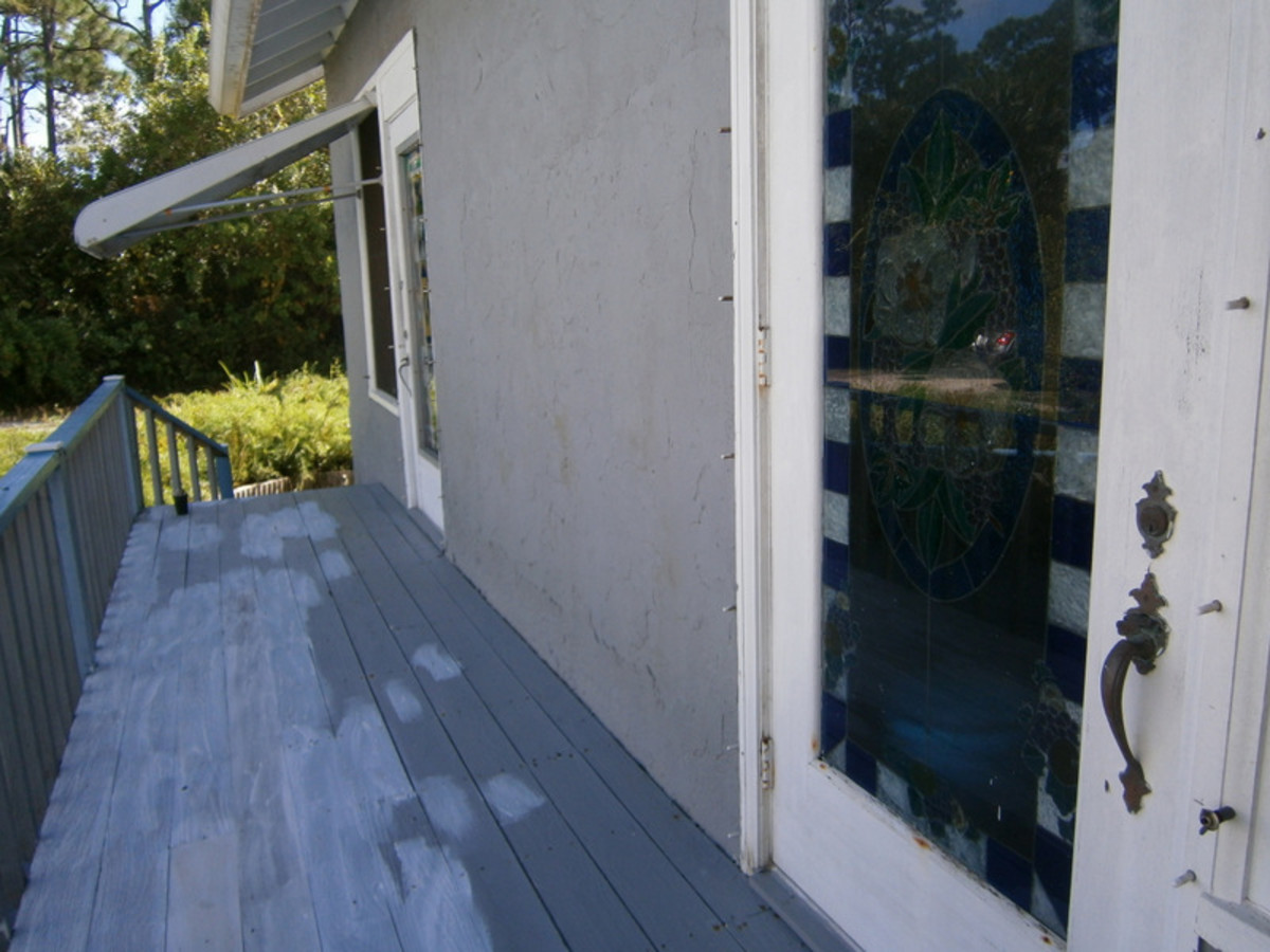 The porch is primed and ready for painting.  You can see my dining room door that I faux-glass stained. Another project!