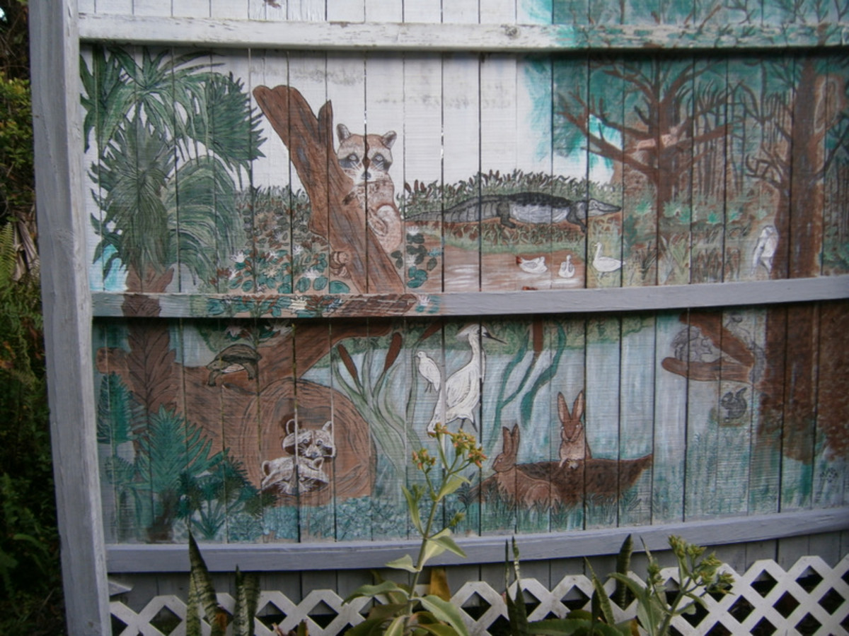 On this half of the fence, I painted Florida animals for my grandchildren.