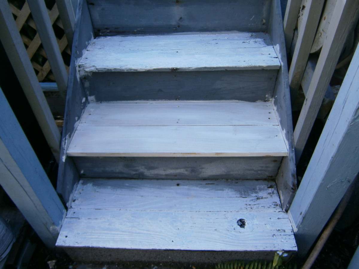 The steps leading up to the porch have been primed with Kilz  and are  ready for painting.