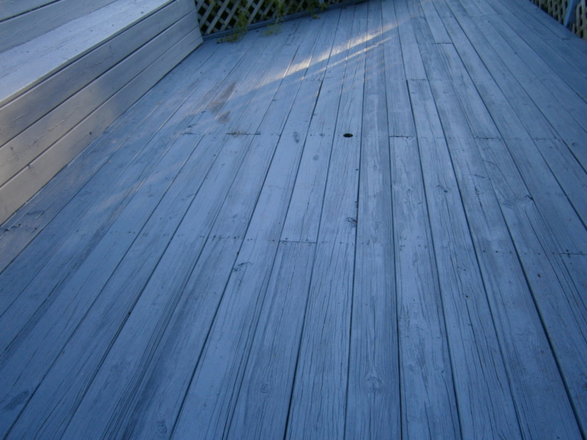 The deck is now painted with the deck and porch enamel. I used Behr's.