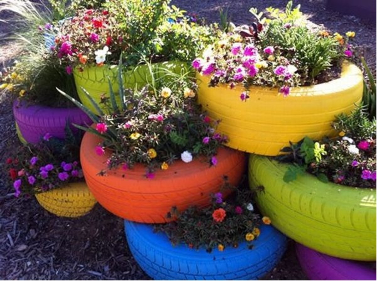 Picture of upcycled old tires as planters.