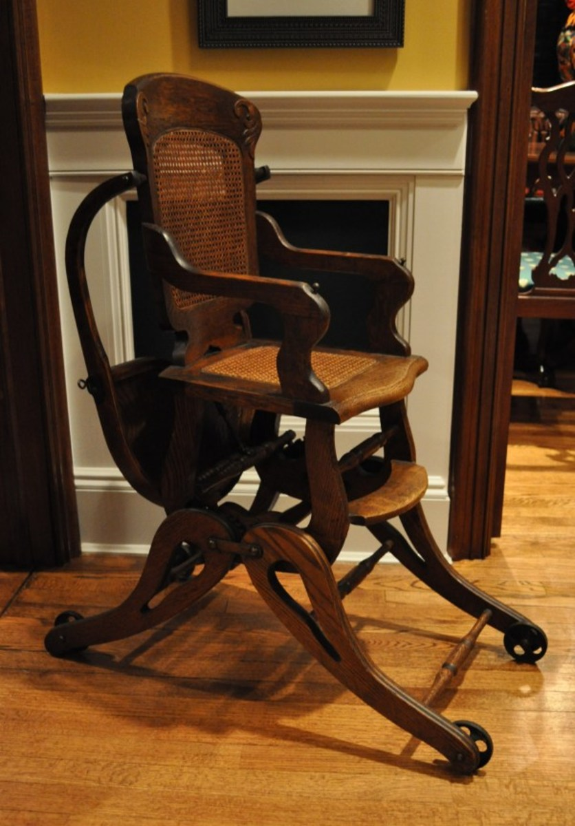 This is an original version of my antique high chair. This pristine chair features all-original parts, including the original wheels, caning, and overhead tray.