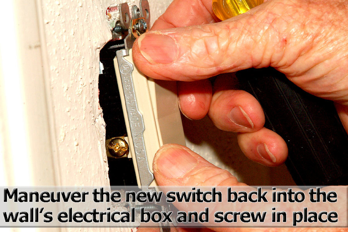 Put the new switch back into the wall's electrical box and secure with the screws.