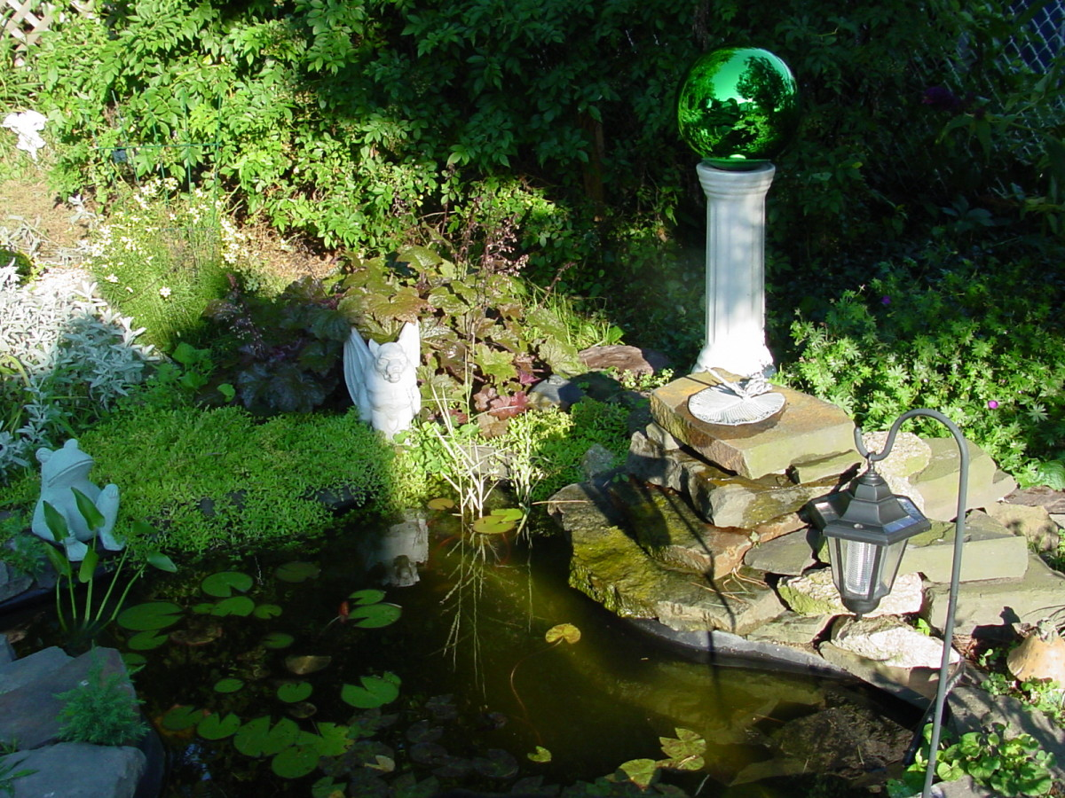 Pre-formed pond with stones and landscaping added.