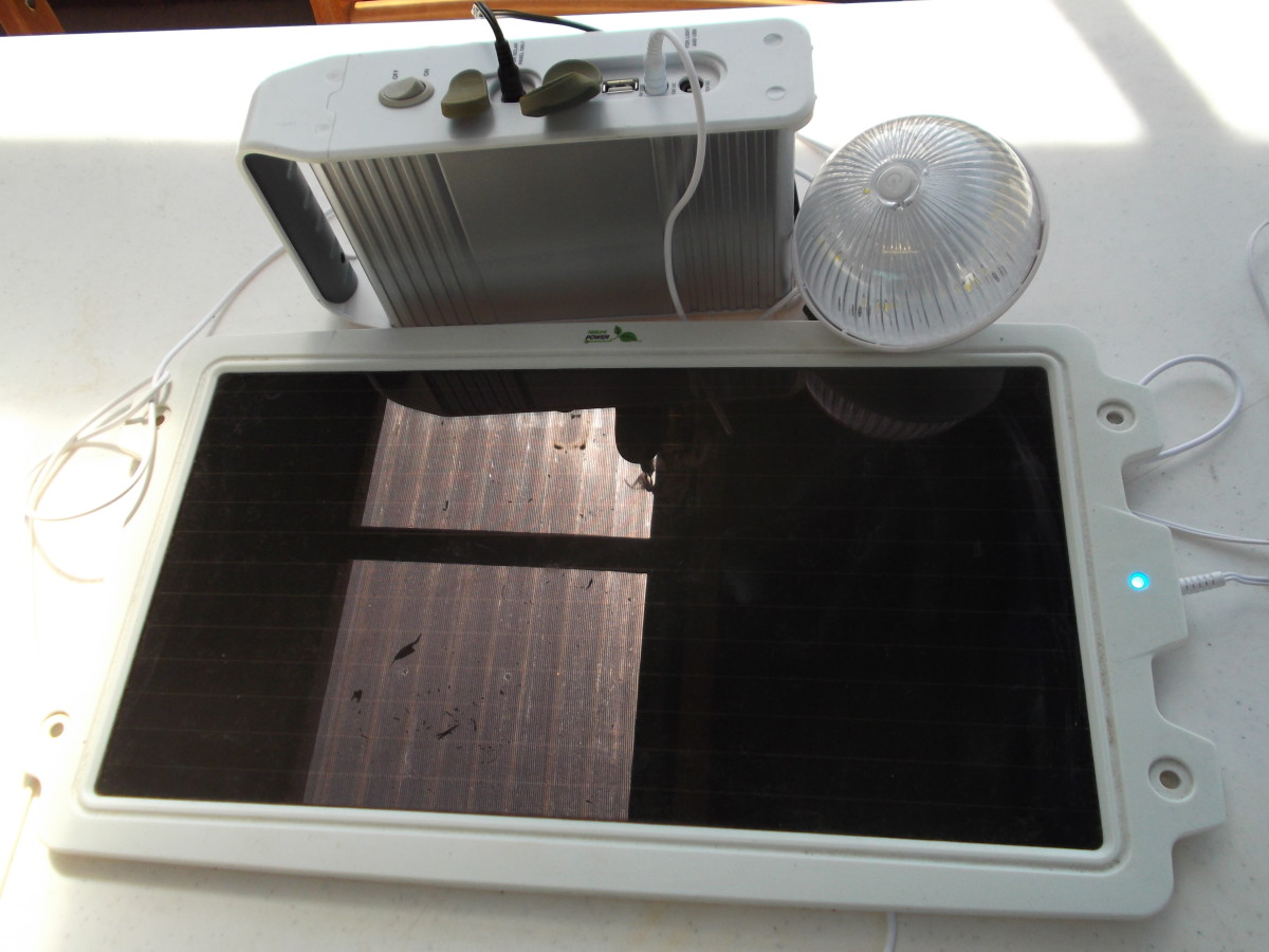 Taken  outside in the undercover area, the reflection in the solar panel is a clear section of the roof above. Note the small blue light on the right side indicates the panel is charging even in low light.