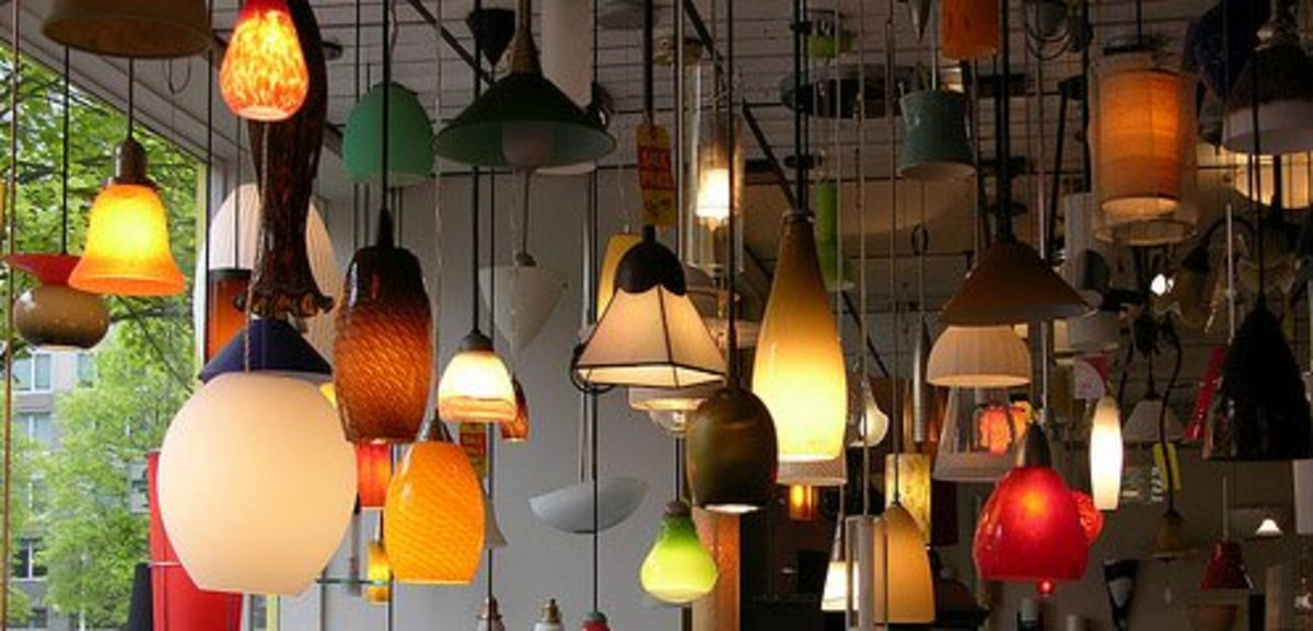 Employ a variety of overhead lighting fixtures to define different areas of an open floor plan.