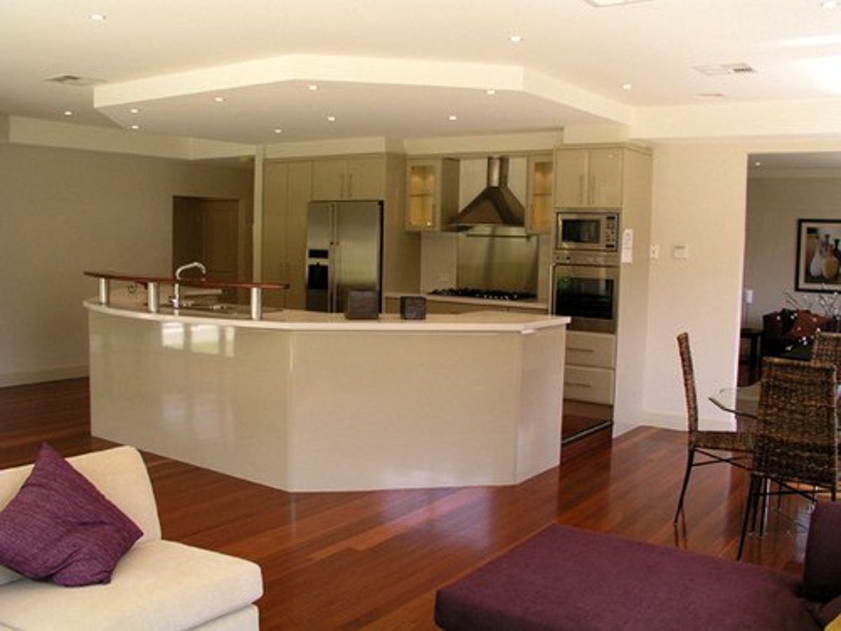 Space adjacent to this kitchen is used for dining and living.