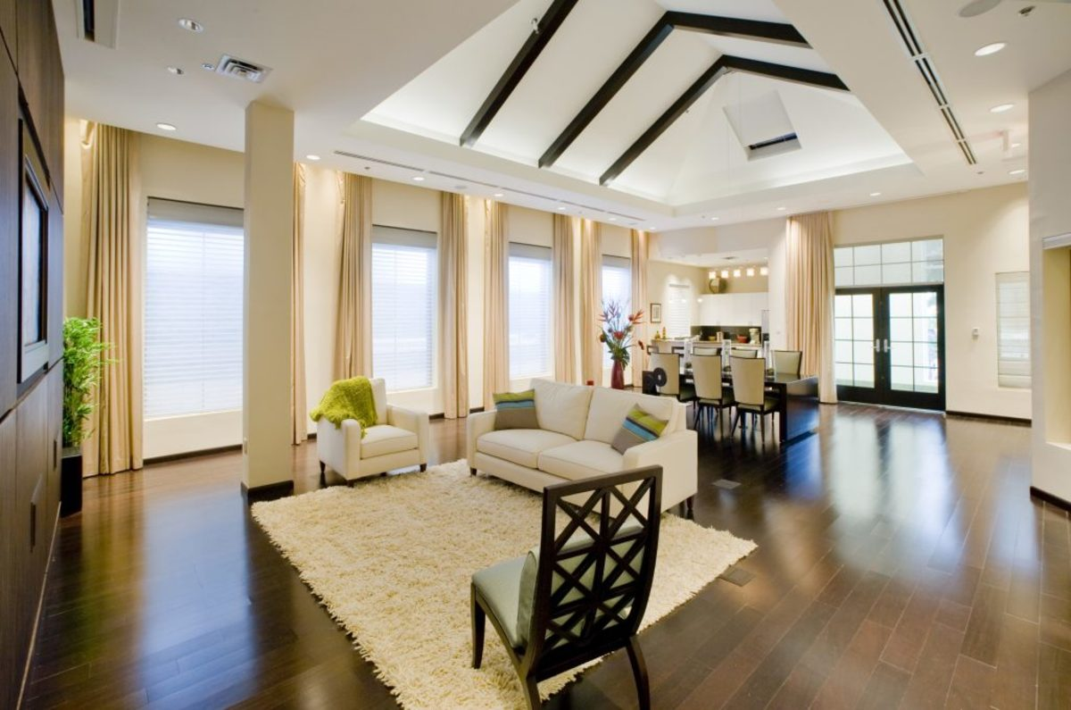 Neutral window coverings throughout an open floor plan gives the space a consistent feel.