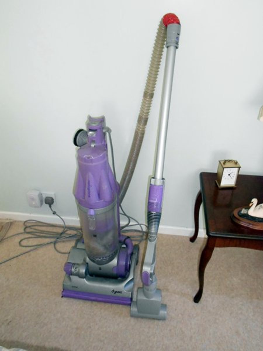 This is my old Dyson, still going strong, despite being mended in a few places and used daily to remove the hair my Jack Russells shed - you would think they would be bald by now!