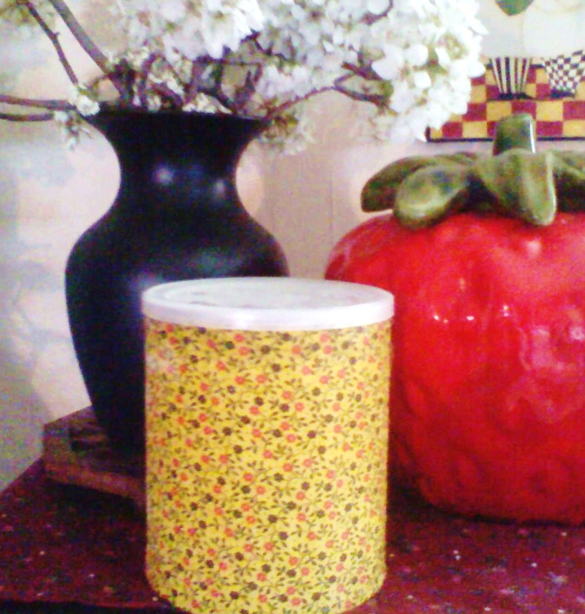 Fabric covered canister for carpet freshener. Nice, vintage look!