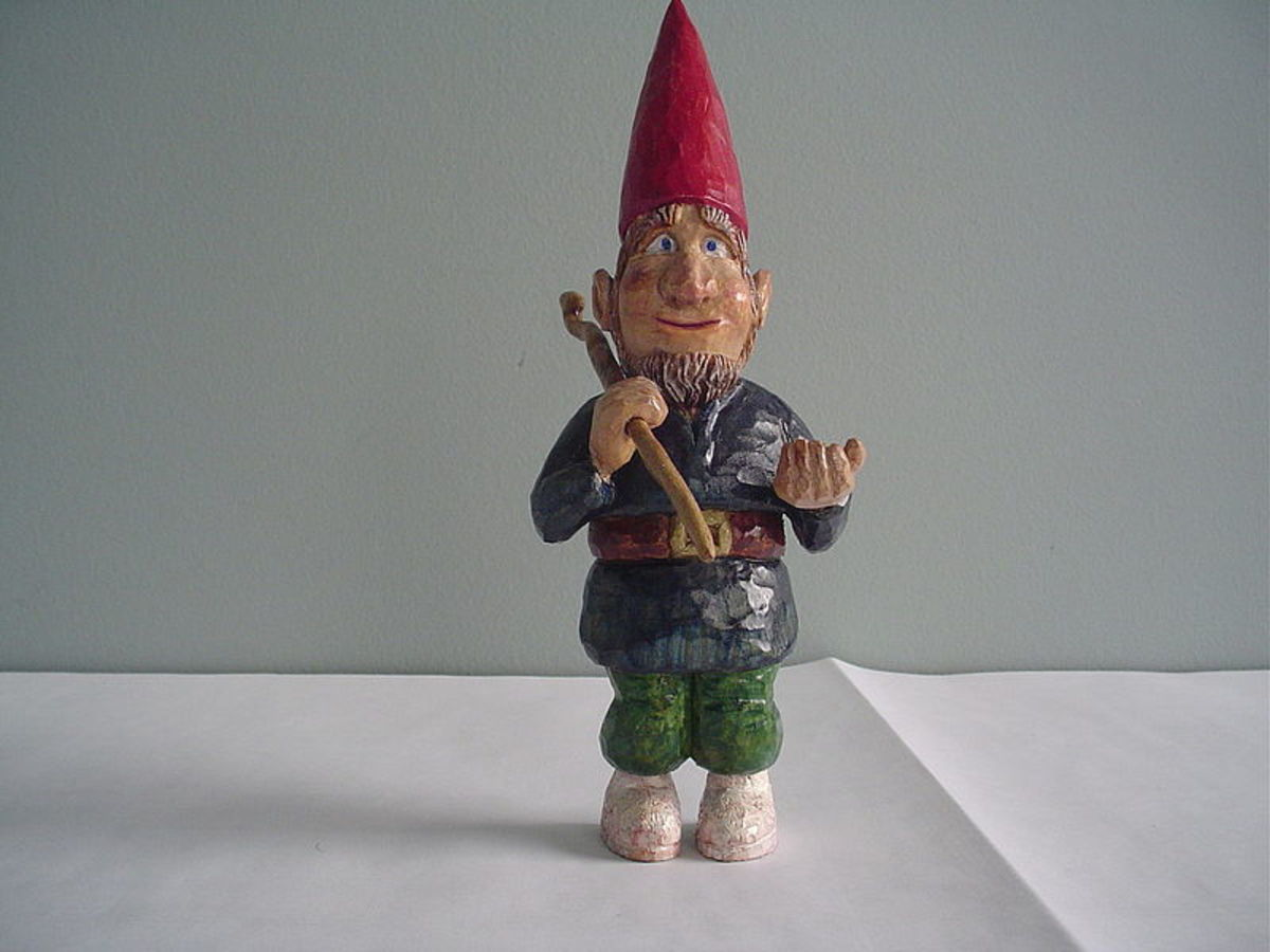Hand carved wooden garden gnome.