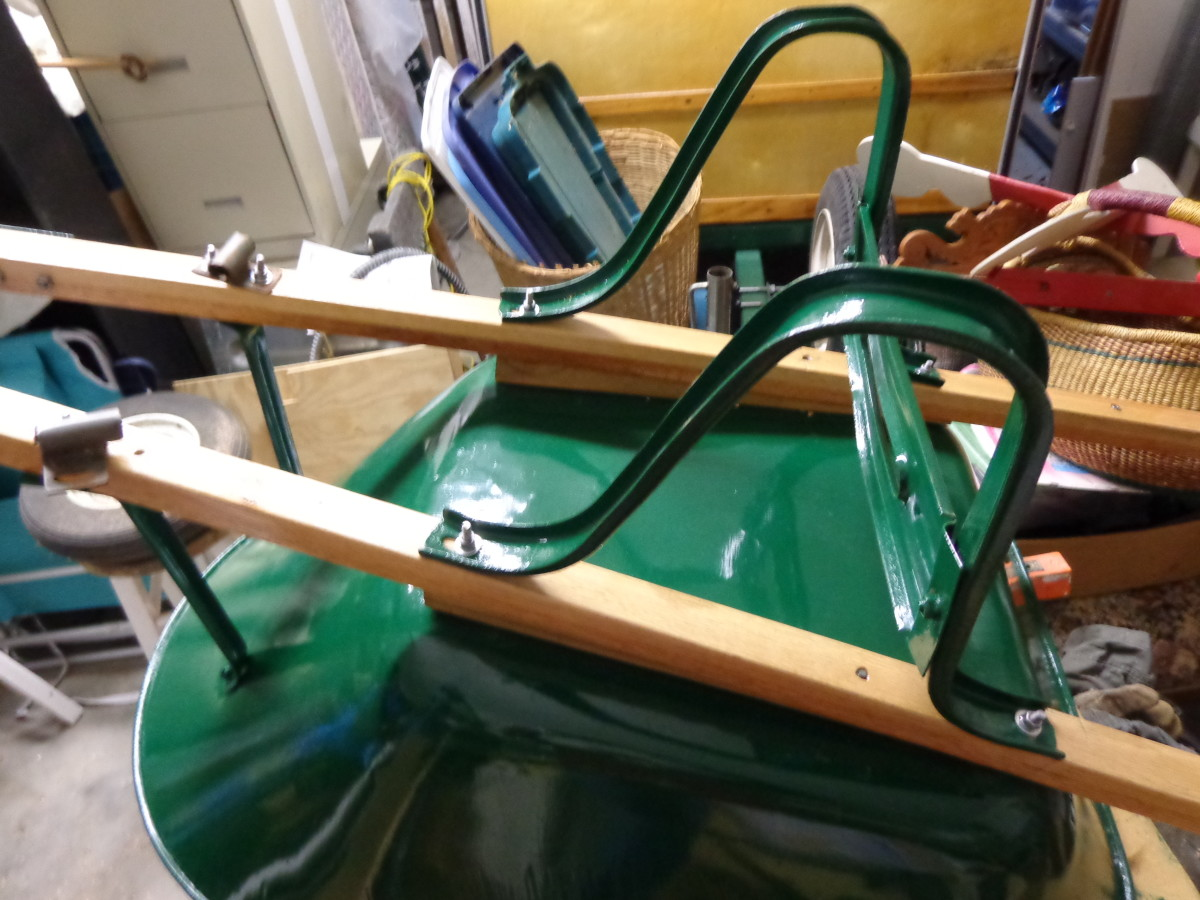 Legs and wedges assembled to handles and to bucket, as well as front braces.  Note that front braces and legs are under stress in their correct positions.  Use the old handles to accurately pre-drill bolt holes, then align metal parts accordingly.