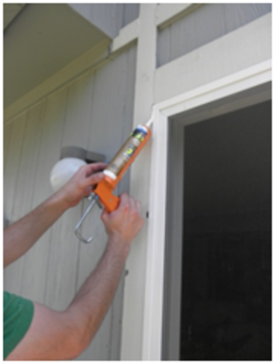 Apply silicone caulking to seal the edges of the doorframe.
