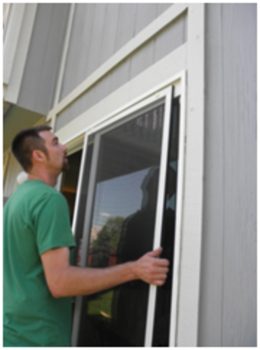 Lift screen door up and into the top track; push the screen up and away to place on bottom track.