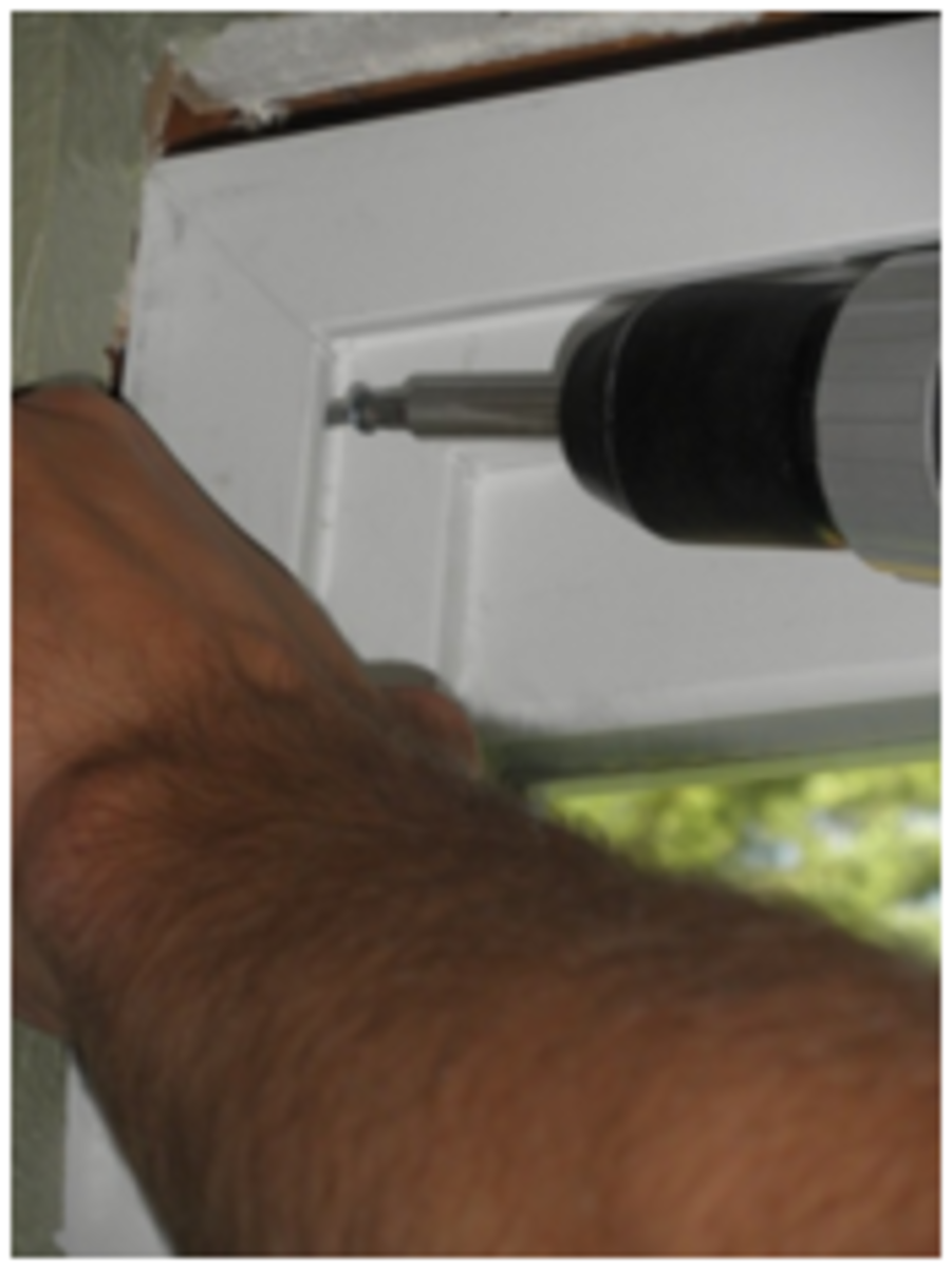 Screw each corner and center of the doorframe to secure.