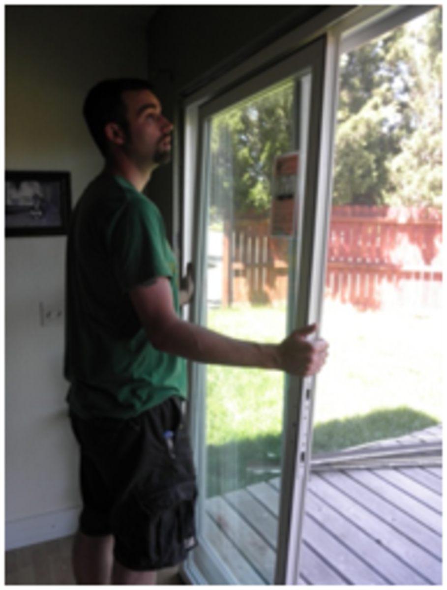 Lift door panel up and into the top track; push the panel up and away to place on bottom track.