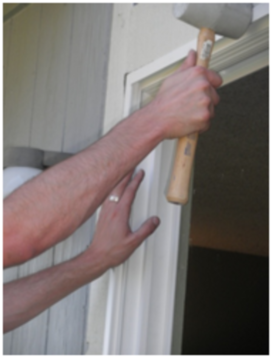 Use a rubber mallet to tap doorframe into place.
