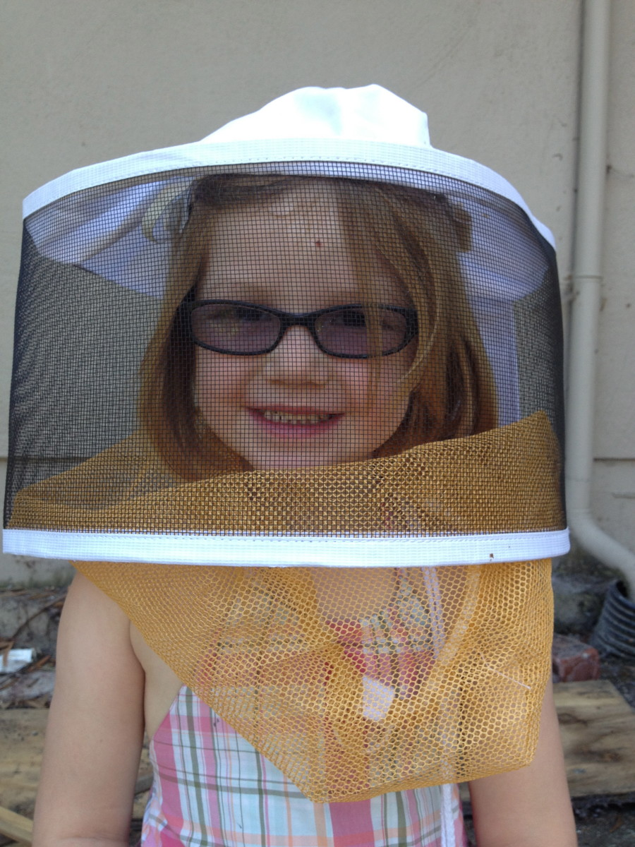 My beekeeping buddy.  She does not go into the hive with me but loves to observe the bees.  :)