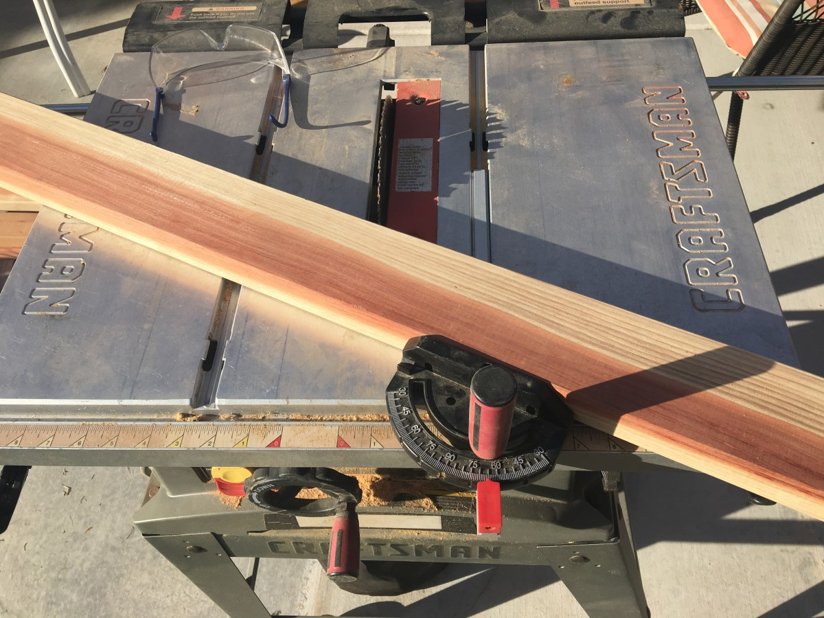 Using a table saw miter gauge to make an angle cut of 25 degrees by setting the indicator at 65 degrees.  Line your pencil mark up with the blade to get the board length you measured.