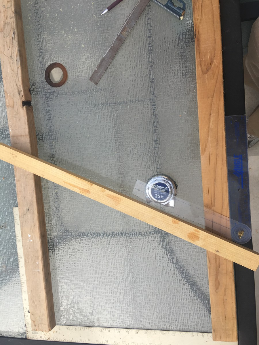 For the purpose of illustration, in this photo the handrail board was moved a lot closer to the carpenter's square representing the floor.