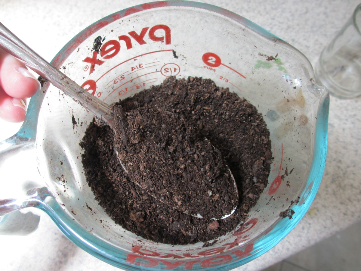 If you're using coffee grounds, mix them with soil.