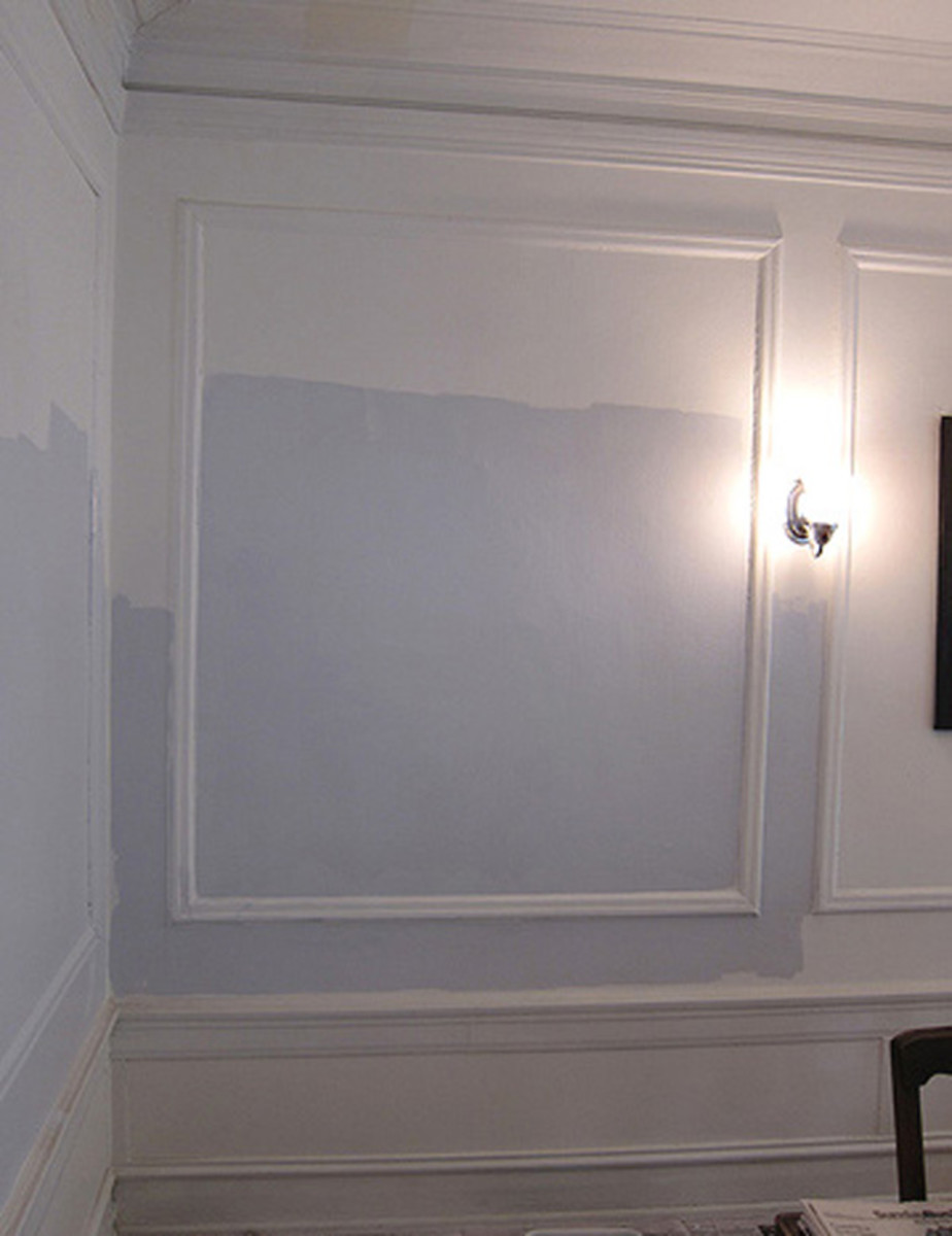 Architectural accents can make a room. This wall features a wainscoting effect and a beautiful blue and white paint combination. This wall has it all!
