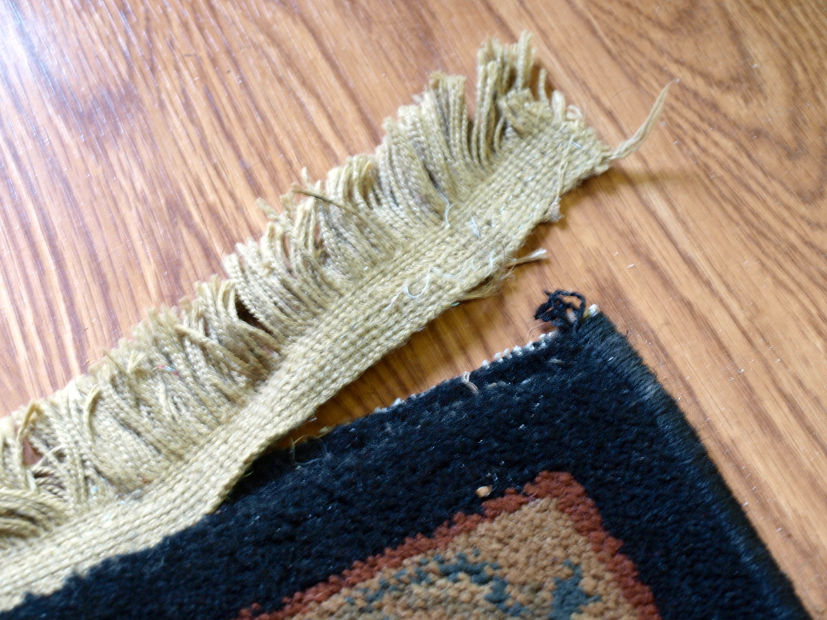Fringe on a rug, torn away after vacuuming.