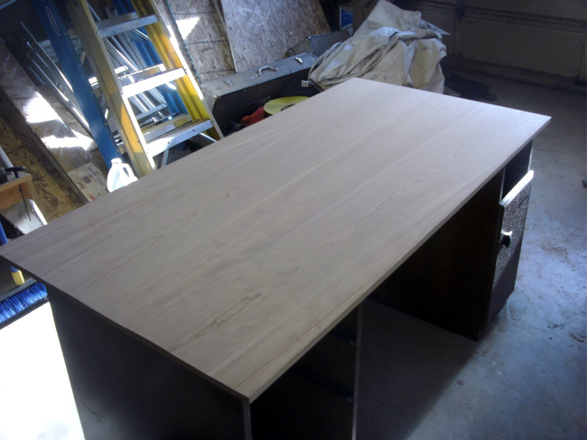 The veneer is in place on the desk