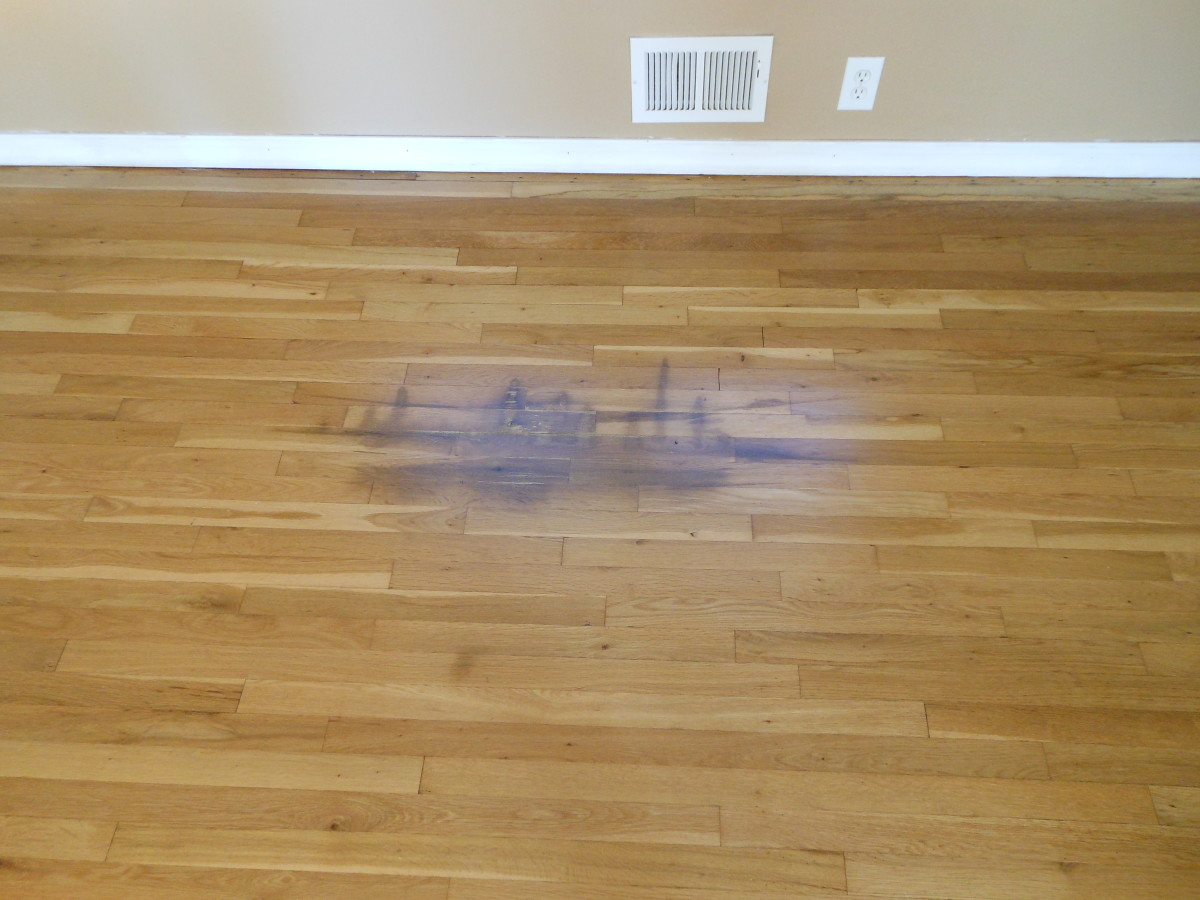 This area of the floor needs refinished to cover the stain.
