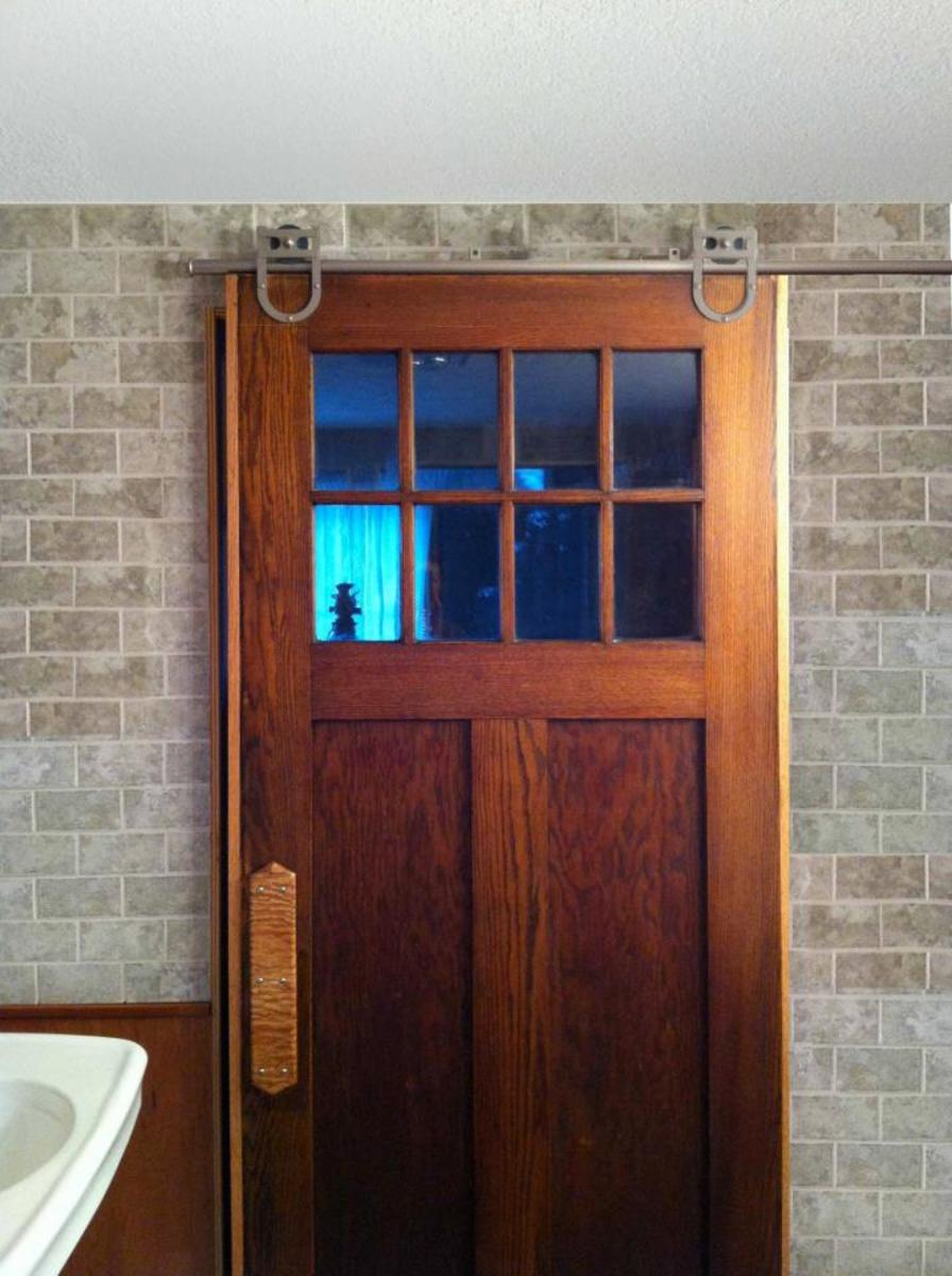 Laundry room rolling door