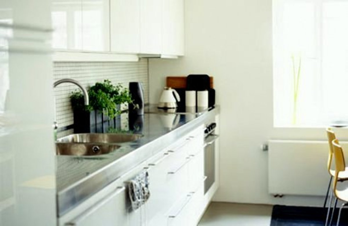 Apply feng shui in a small kitchen through good lighting, storage space and color.