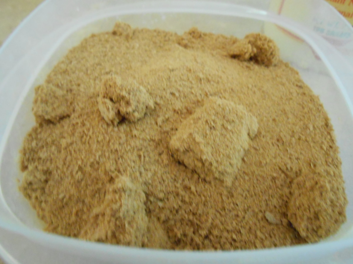 Nutritional yeast poured into a solid plastic container.