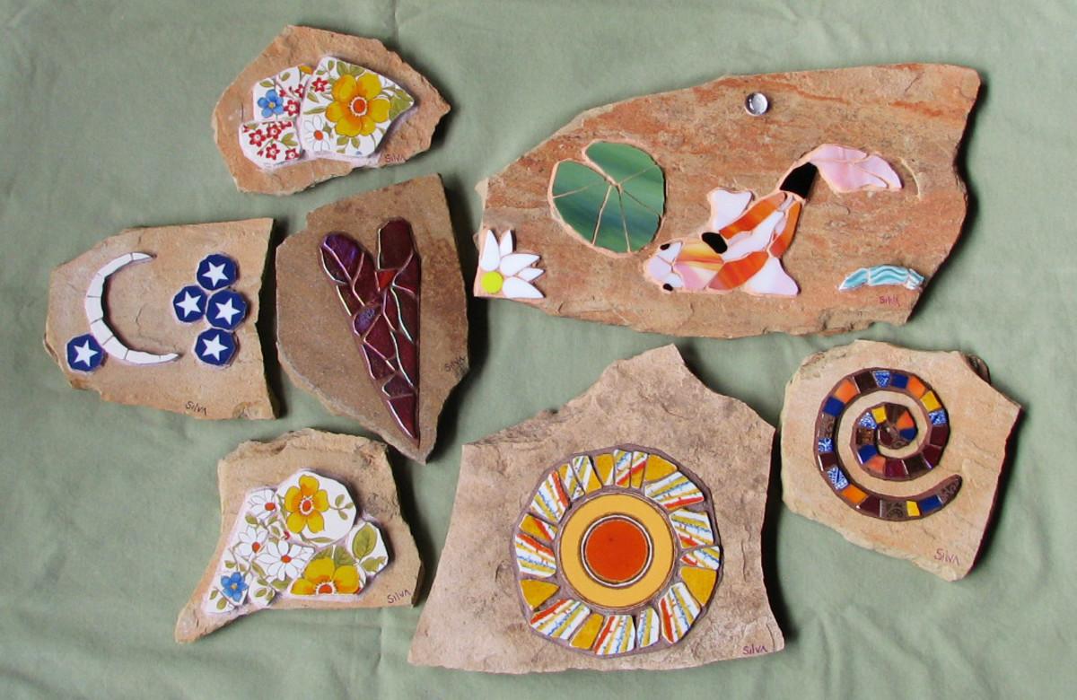 mosaic koi, spiral, heart, sun, moon, stars, and flower garden stones