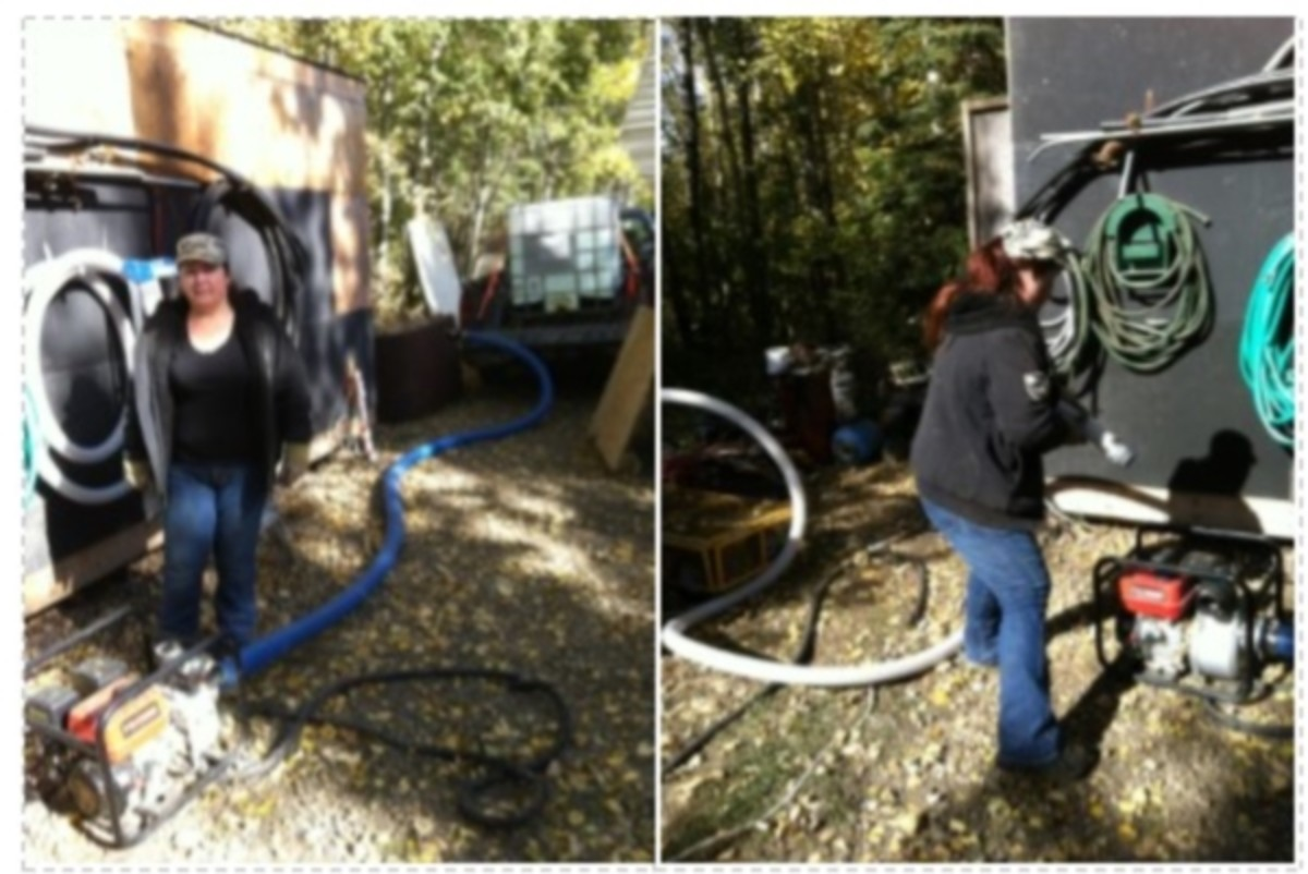 """The 3"""" transfer pump connecting the 250 gallon water tote on the pickup to the cistern inside the building."""