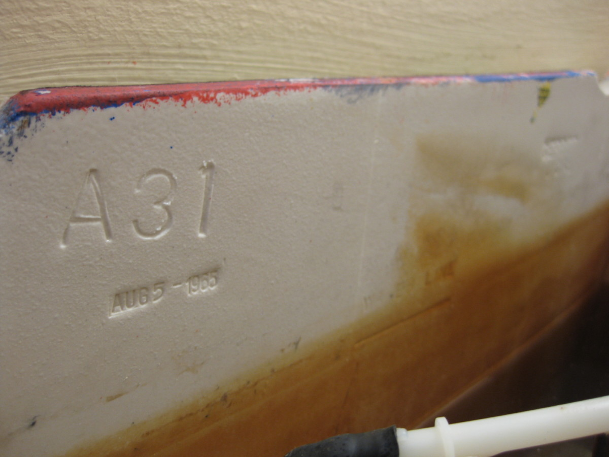This is the inside tank of a Gerber toilet. The date (Aug 5, 1965) is stamped on the left side; the brand name is stamped on the right.