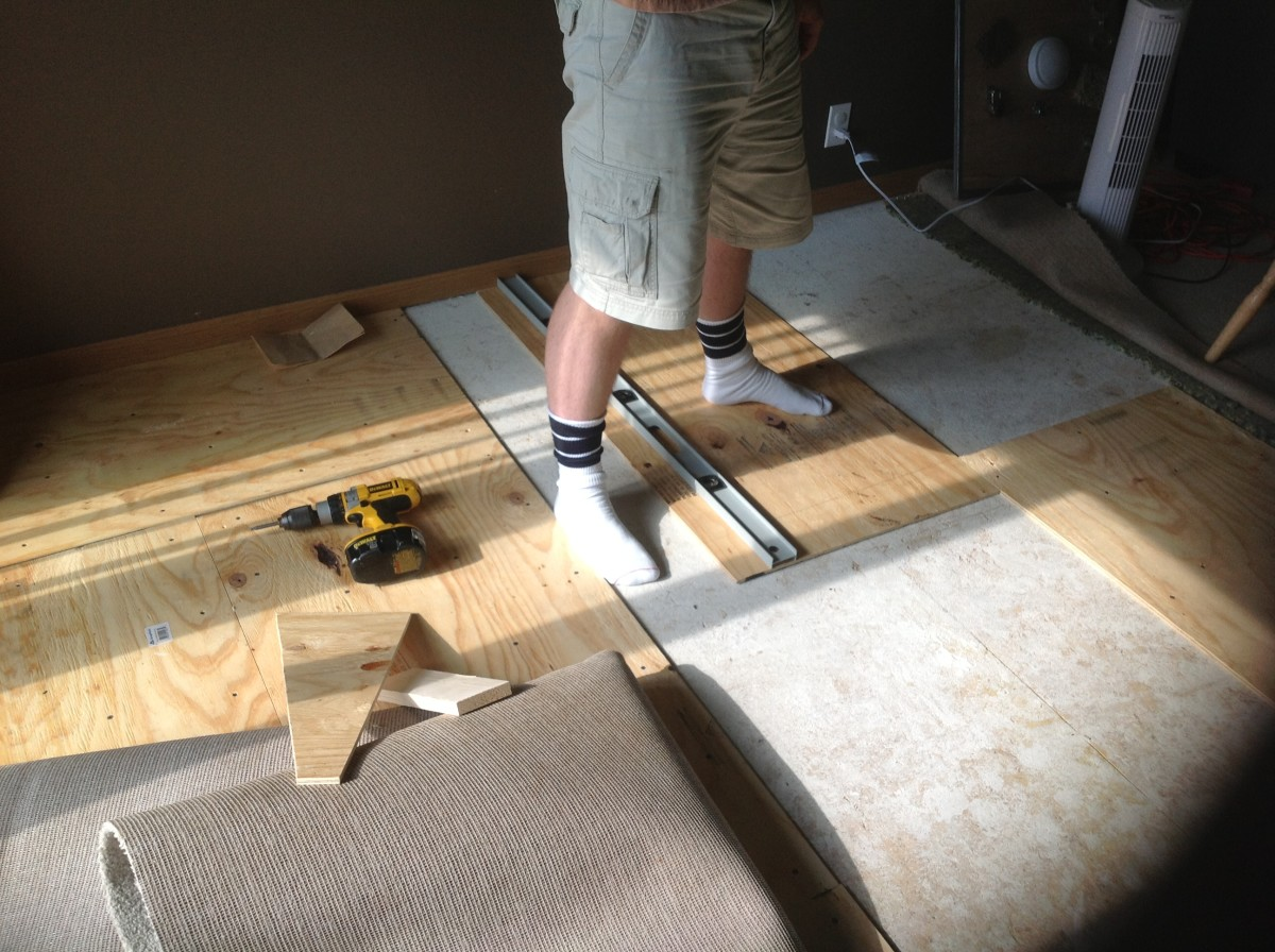 Putting in the subfloor where the carpet used to be.