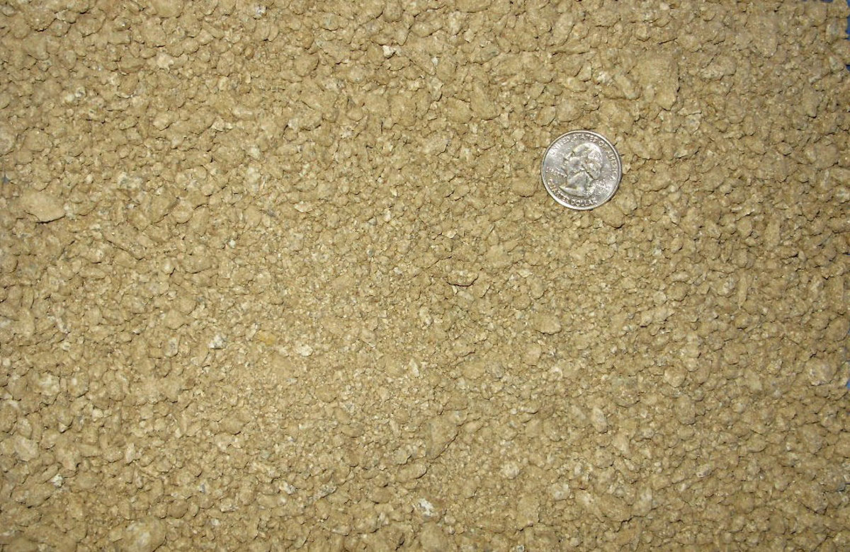 This is decomposed granite, with a quarter for size reference.