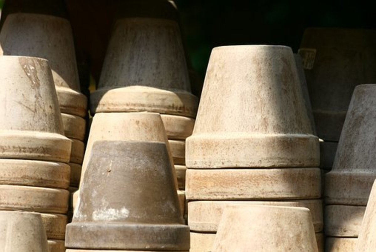 Clay containers should not be stored in a stack.  The weight could break the bottom ones.