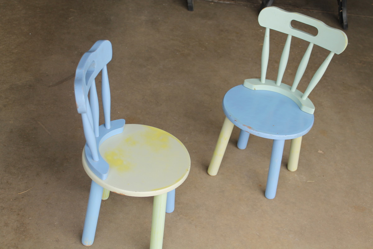 Some chairs in need of fresh paint.
