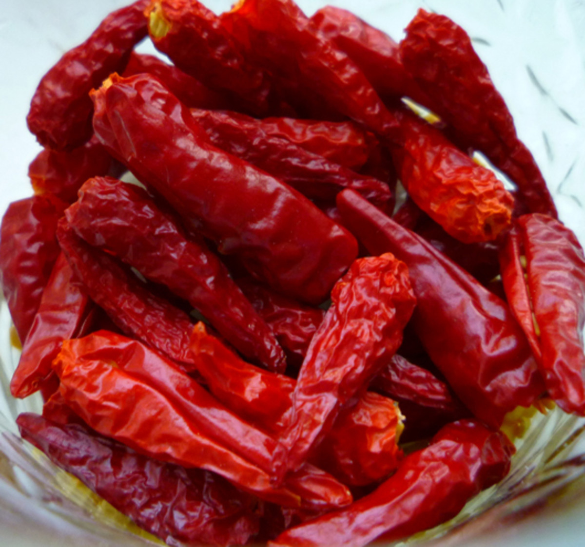 Dried pequin peppers. Containing a bit of heat, these dried peppers have a superb smoky flavor that pairs well with many cuisines!
