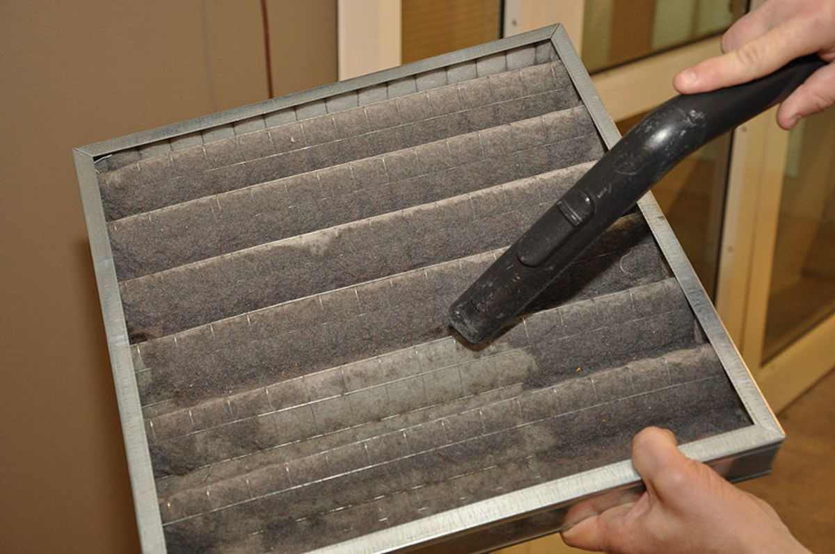 Vacuum cleaning an air cooler filter.
