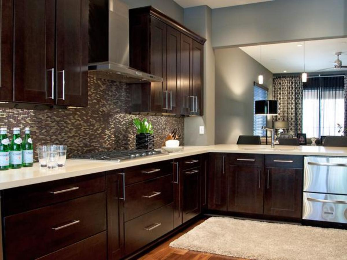 Espresso Kitchen cabinets with white quartz tops and stainless steel appliances. A very popular combination.
